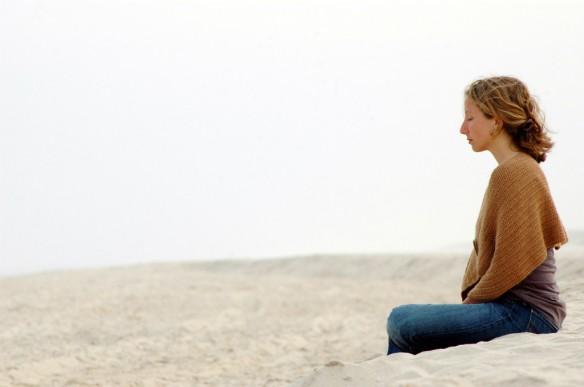 woman-meditating-beach-1024x680