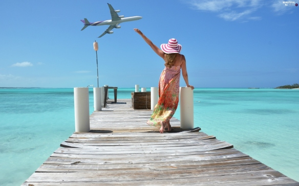 sea-tropical-women-plane-pier.jpg